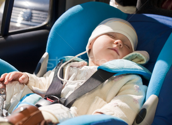 Toddler in a car seat Stock photo © naumoid