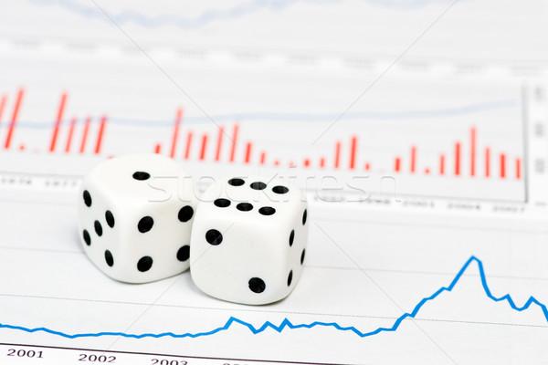 Dice on figures Stock photo © naumoid