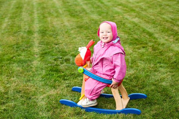 Toddler on rocking horse Stock photo © naumoid
