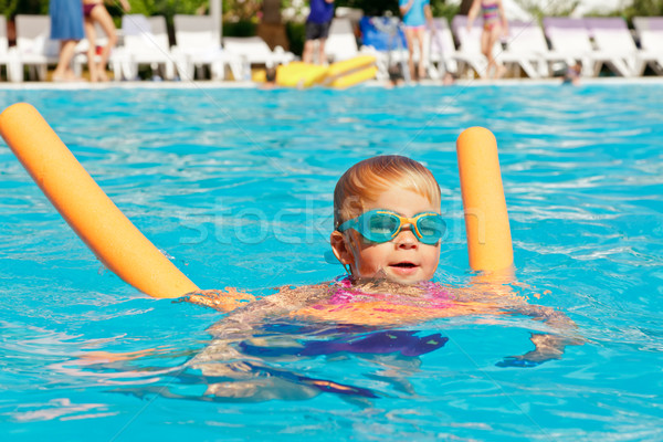 Child in a swimming pool Stock photo © naumoid