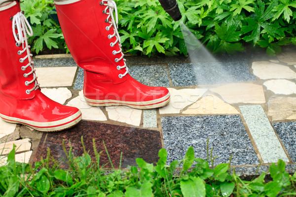 Alto pressão lavagem pessoa vermelho limpeza Foto stock © naumoid