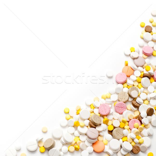 Tabletták halom egészség csoport kémia citromsárga Stock fotó © naumoid