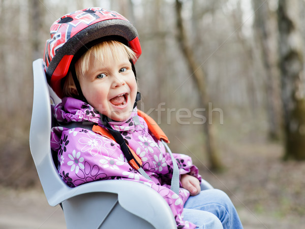 Child in bike seat Stock photo © naumoid