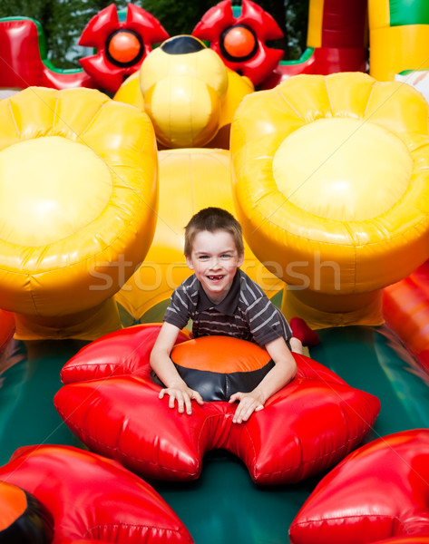 Boy in inflatable playground Stock photo © naumoid