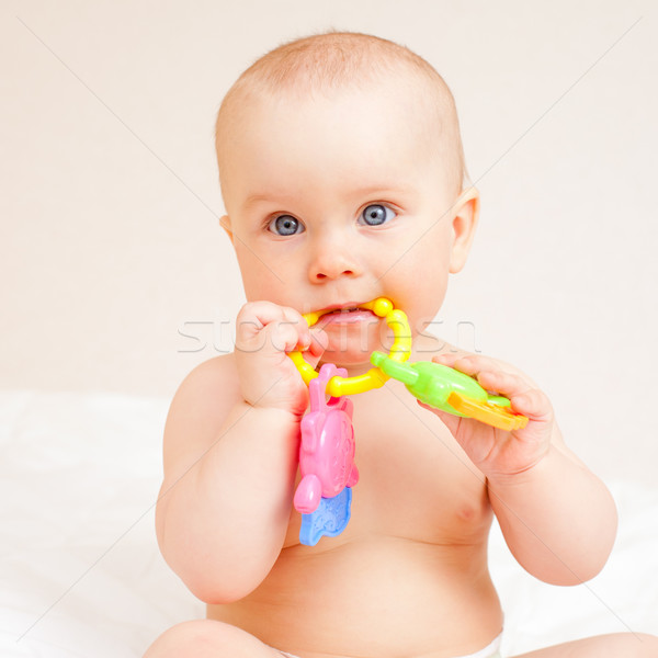 Infant with teething toy Stock photo © naumoid