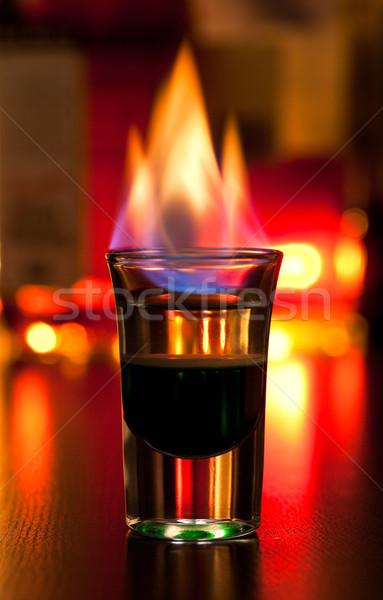 Vlammende cocktail brandend shot glas tabel Stockfoto © naumoid