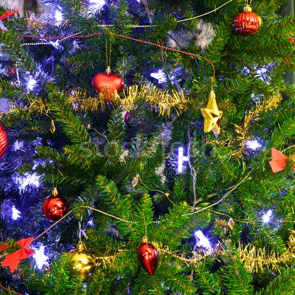 Arbre de noël décoration pourpre lumières décoré arbre Photo stock © naumoid