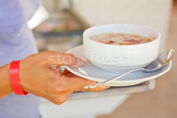 Hand halten Suppe tragen Armband Stock foto © naumoid