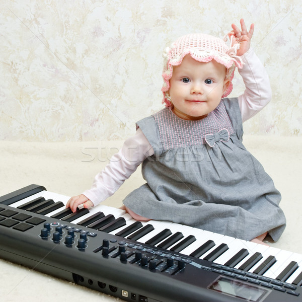 Infant with piano Stock photo © naumoid