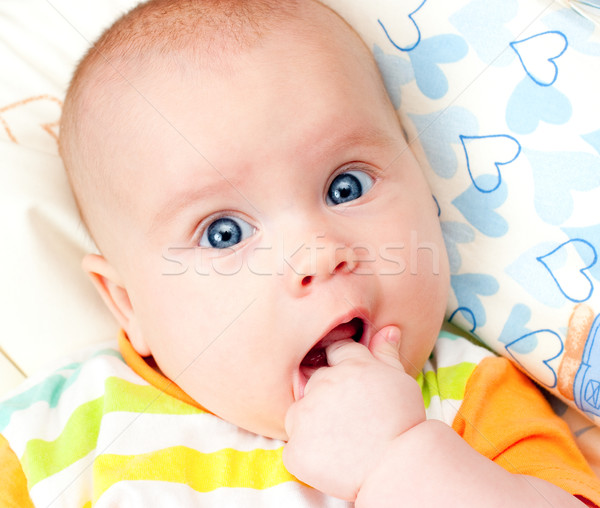 Infant with hand in mouth Stock photo © naumoid