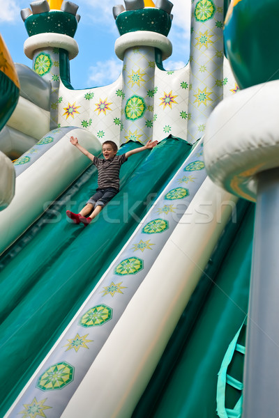 Boy in inflatable castle Stock photo © naumoid