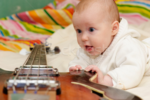 Infant and the bass guitar Stock photo © naumoid