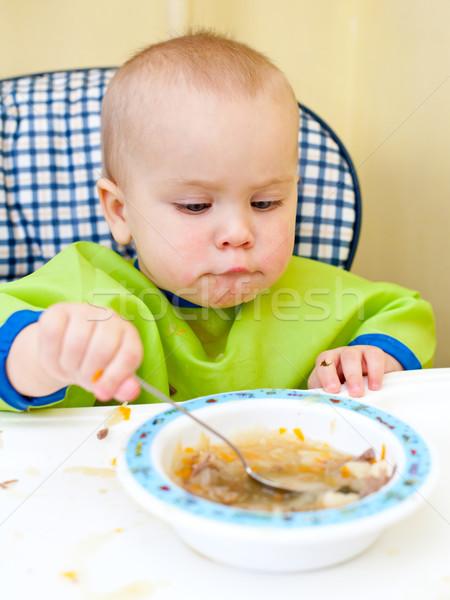 Baby eating Stock photo © naumoid