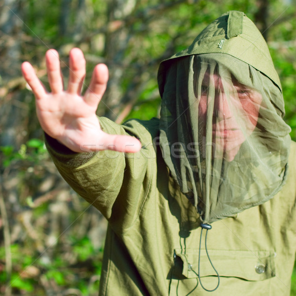 Man in encephalitis protective clothing Stock photo © naumoid