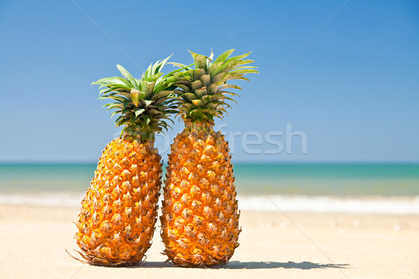 Pineapples on the beach Stock photo © naumoid