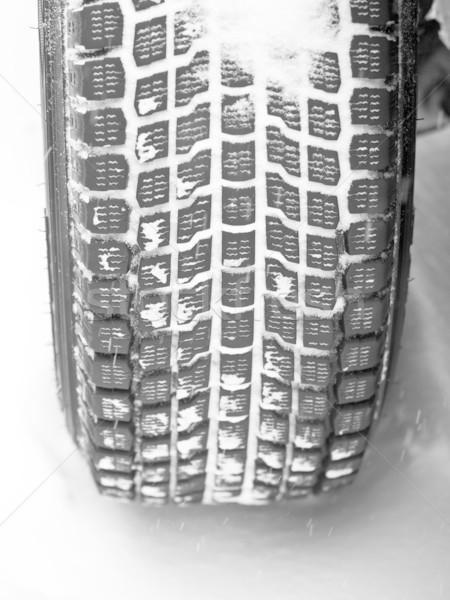 Winter tyre on a vehicle Stock photo © naumoid