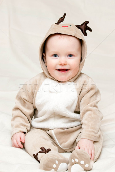 Infant in deer costume Stock photo © naumoid