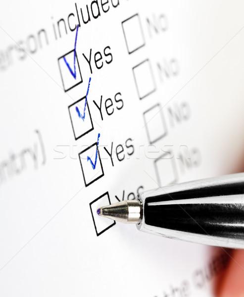 Enquête main stylo vérifier boîte oui Photo stock © naumoid