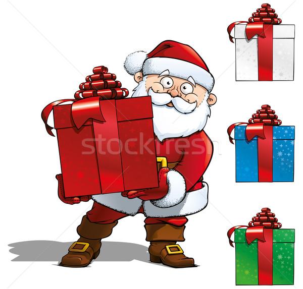 Santa Holding a Gift Stock photo © nazlisart
