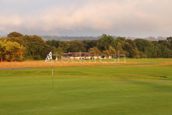 Golf Flagge Dämmerung Landschaft Bäume grünen Stock foto © ndjohnston