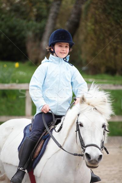 Fille équitation cheval heureux Photo stock © ndjohnston