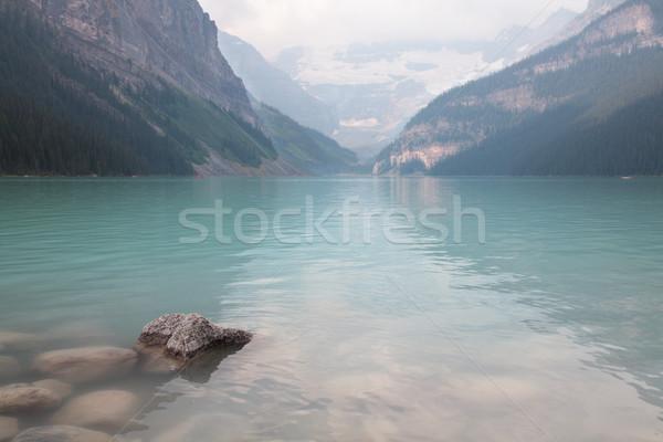 Göl kayalar ön plan su dağ mavi Stok fotoğraf © ndjohnston