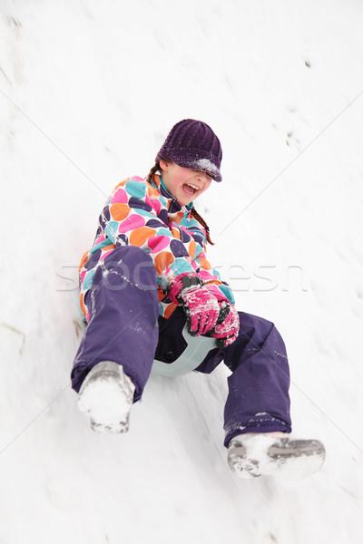 Mädchen Kunststoff nach unten Hügel Bewegungsunschärfe Schnee Stock foto © ndjohnston