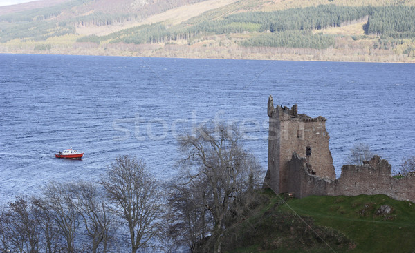 Urquhart Castle with a boat on Loch Ness Stock photo © ndjohnston