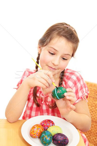 Kız boyama paskalya yumurtası küçük kız Stok fotoğraf © ndjohnston