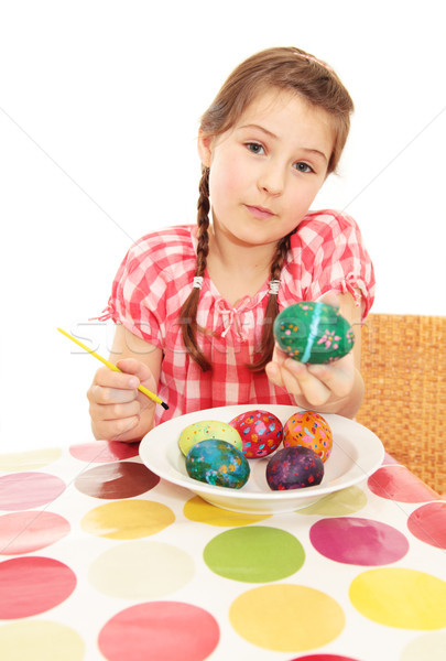 Kız boyalı easter egg Stok fotoğraf © ndjohnston