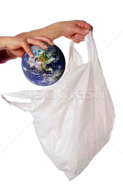 World being put into a plastic bag Stock photo © ndjohnston