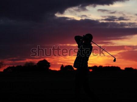 Golfçü akşam karanlığı ışık oynama Stok fotoğraf © ndjohnston