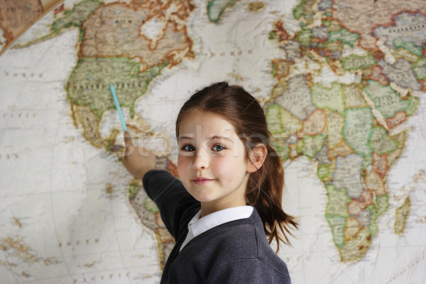 School girl indicating America on a map  Stock photo © ndjohnston