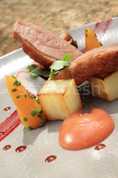Tava ördek yemek havuç Stok fotoğraf © neillangan