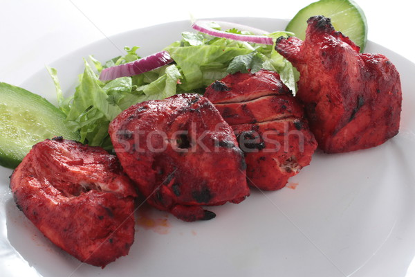 Tavuk Hint kebap alev ızgara salata Stok fotoğraf © neillangan