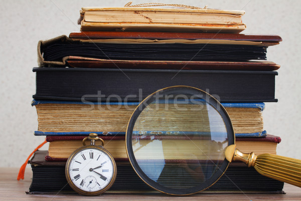 antique clock with loupe  on books background Stock photo © neirfy