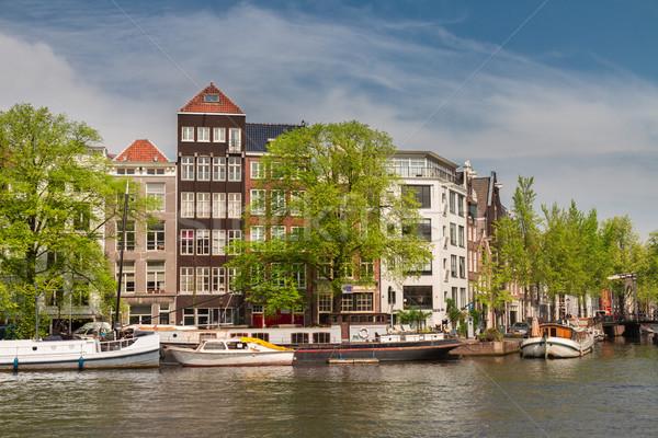 Folyópart Amszterdam öreg történelmi házak folyó Stock fotó © neirfy