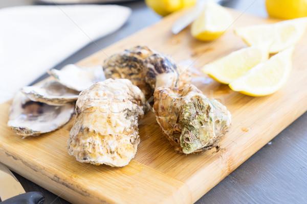 Raw oysters shells Stock photo © neirfy