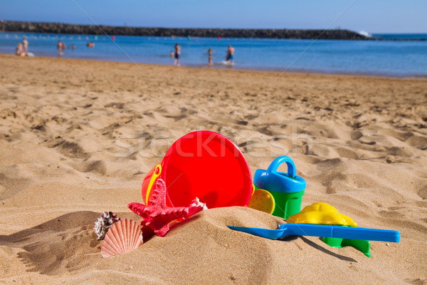 bucket with plastic beach toys in sand on sea shore Stock photo © neirfy