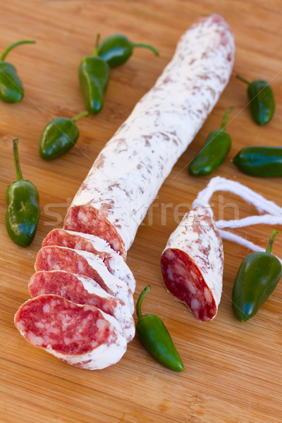 Stock photo: Meat fuet sausages with green peppers