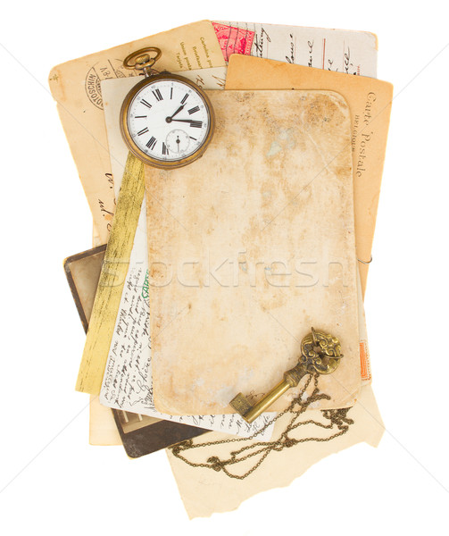 pile of old photos and papers with antique clock Stock photo © neirfy