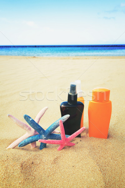suntun creams on sandy beach Stock photo © neirfy
