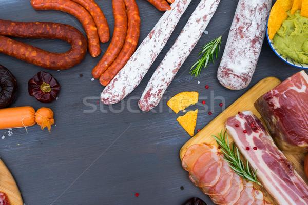 Piknik asztal spanyol kolbász tapas szalámi chorizo Stock fotó © neirfy