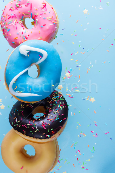 flying doughnuts on blue Stock photo © neirfy