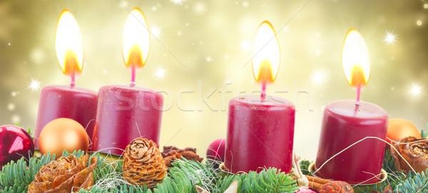 Advent koszorú égő gyertyák örökzöld fenyőfa Stock fotó © neirfy
