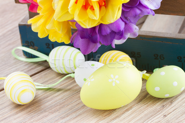 easter eggs and posy  of spring flowers on wooden table Stock photo © neirfy