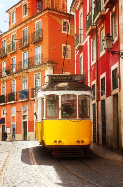 Villamos keskeny utca Lisszabon citromsárga Portugália Stock fotó © neirfy
