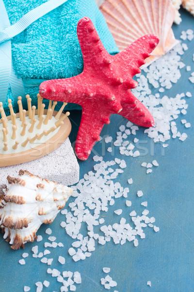 Rosso starfish mare trattamento termale blu tavolo in legno Foto d'archivio © neirfy