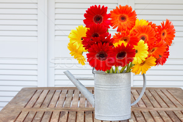 bouquet of gerberas on wooden table Stock photo © neirfy