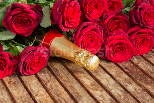 crimson  red  roses with neck of champagne Stock photo © neirfy